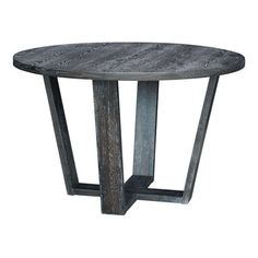 We love the casual elegance of this urban rustic dining table. Its round top and sturdy open base is finished in a handsome gray wash with just the right amount of distressing. Perfect for dinner parties or family gatherings. Pair it with four of the matching dining chairs.