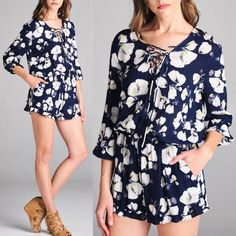 YURI lace up front floral romper - NAVY LACE UP FRONT ROLL up SLEEVE ELASTIC WAIST FLORAL PRINT ROMPER with pockets.  Fabric 100% rayon NO TRADE, PRICE FIRM Bellanblue Pants Jumpsuits & Rompers