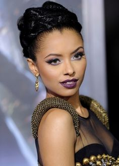 Kat Graham. Amazing vampy purple look!  I would really love to know who does her makeup...she always has some great red carpet looks.