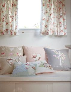 cute little curtains...i could make those pillows too!