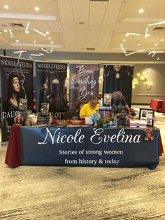 Fabulous table by author Nicole Evelina, manned by her able assistant! https://nicoleevelina.com/