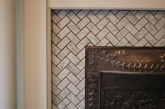 Carrera marble herringbone & subway fireplace tile
