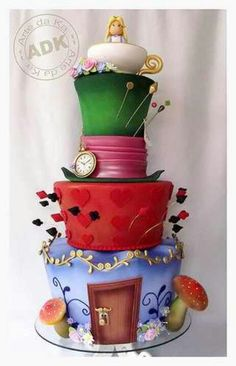 Alice in wonderland cake...I think I'd like it more if it didn't have her in the cup...don't like they made her.