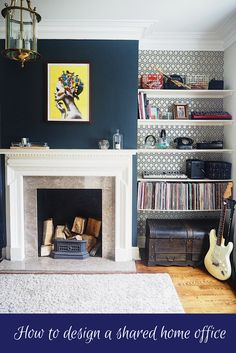 How to design a shared home office. Husband wife office share. Masculine Interiors. Dark Interiors. Dark Style. Railings by Farrow & Ball. Marble fireplace. Ellie Vandoorne bird woman art. Hicks Hexagon wallpaper Cole & Son. Music Room. Craft Room. Vinyl Records. Period home. Navy blue interiors. Navy blue walls. Dark walls. Dark paint.