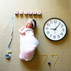 Cute newborn photo announcement idea to share baby's name, height, weight and time of birth.
