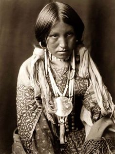 Here for your perusal is an original photograph of a Jicarilla Child. It was created in 1905 by Edward S. Curtis.  The photograph illustrates a Half-length portrait of a young Jicarilla Woman.  We have compiled this collection of photographs mainly to serve as a valuable educational resource. Contact curator@old-picture.com.