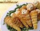 Cannoli e coni di pasta sfoglia salati