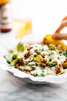 Spicy Lentil Nachos with Three Cheese Sauce - you will not believe how good these are! Saucy filling with a velvety homemade cheese sauce. Vegetarian. #appetizers #snack #vegetarian #easyrecipe | pinchofyum.com
