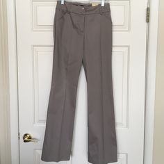 Tribal dress casual pants With tags, never worn.  Cotton/spandex, sits just below waist, slight flare, stitch detailing around pockets and waist band Tribal Pants Boot Cut & Flare