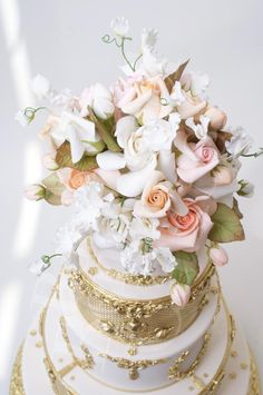 The floral topper of sugar Spring roses and sweet-peas....cake by the famous Ron Ben-Isreal!!!