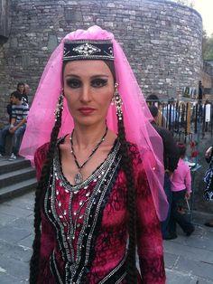 Georgian (ქართული ენა, pronounced [kʰartʰuli ɛna]) dancer; a country in the Caucasus.