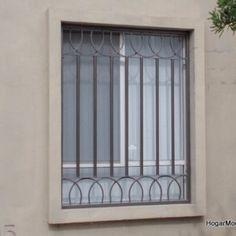 Rejas verticales con detalle para ventana