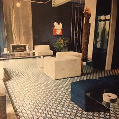 Francois Catroux interior for Mme. Raymonde Zehnacker. A modern, geometric delight, her Paris apartment includes David Hicks carpeting, lofty, midnight-blue lacquer doors, roughed-up white linen sofas & chairs, and an African carved-wood sentinel. Horst, 1970. #francoiscatroux #horst #voguemagazine