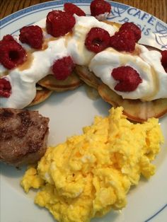 Saturday morning breakfast! Gluten free almond flour silver dollar pancakes with lots of whipped cream, fresh raspberries, and a drizzle of Vermont maple syrup, scrambled farm eggs, and organic pork breakfast sausage.