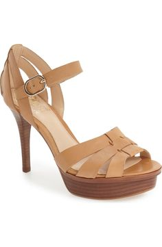 Head over heels for this chic Vince Camuto sandal lifted by a stacked platform and tapered stiletto.