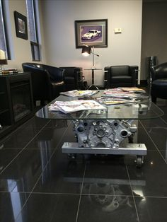 Engine table in the waiting room. Waiting Room Design, Waiting Area, Mechanic Shop, Mechanic Garage, Engine Table, Service Auto, Automotive Shops, Automotive Decor, Office Waiting Rooms