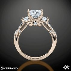 This 3 Stone Engagement Ring is from the Verragio Insignia Collection. It features 0.50ctw (F/G VS) of Princess and Round Brilliant Diamond Melee to enhance a princess or radiant diamond center of your choice. The width tapers from 2.7mm at the top down to 2.2mm at the bottom. Select your diamond from our extensive online diamond inventory. Please allow 4 weeks for completion. Platinum rings carry a 5 week turnaround time. If you have any questions regarding this item then please contact one…