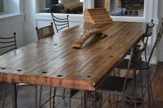 Reclaimed Railcar flooring made into a dining table.