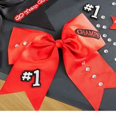 Personalize a pre-made cheer bow in minutes with iron-on gems and appliques for DIY style team spirit