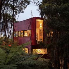 The Titirangi Red House: Location: Titirangi, Auckland, New Zealand Year of Construction: 2012 Architects: Crosson Clarke Carnachan Architects  Surrounded by nature on all sides, this residence has windows that look out onto the outdoors.