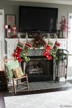 One of the biggest challenges in home decorating is how to decorate your mantel with a TV. This post highlights several different ideas on how to do just that! Must pin to remember this one. Outdoor Christmas, Christmas Home, Christmas Wreaths, Christmas Decorations, Christmas Ideas, Vintage Christmas, Christmas Villages, Victorian Christmas, Vintage Santas