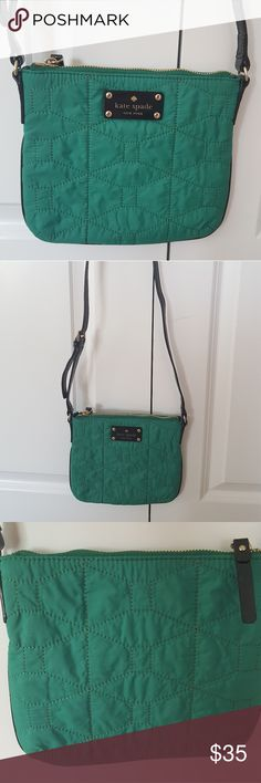 Kate Spade Crossbody This Kate Spade cross-body is a beautiful emerald green color. It is 8.5 inches across and is 7.25 inches tall. This purse is new without tags except for the care card which will come with the bag. The zipper sometimes has trouble zipping closed but it is not broken. There are not any pockets on the inside kate spade Bags Crossbody Bags
