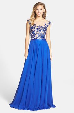 Free shipping and returns on Sherri Hill Embellished Illusion Gown at Nordstrom.com. Exquisite sequins and beads trace a garden of flowers over the cap-sleeve illusion bodice of a stunning gown that flares to a trailing chiffon skirt.
