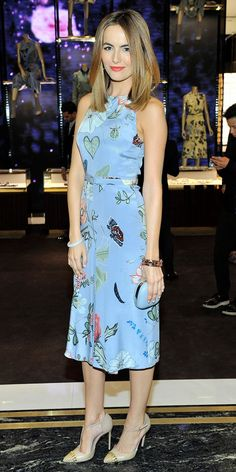 Camilla Belle looks elegant in a blue floral Gucci dress and studded pumps.