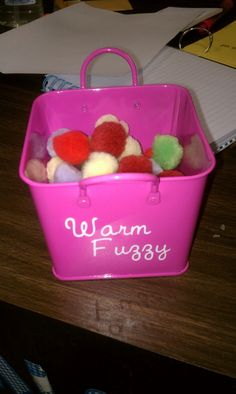 "Too cute! As a class incentive: whenever the class does something that gives the teacher a ""warm fuzzy"" add a craft pom to the basket. After filling the basket with a set number (10) of poms ahem... warm fuzzies, the class gets a reward."