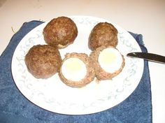Scotch Eggs -- [Note: click-through is a discussion thread; scroll down to #75 & 78 to find photo and recipe.]