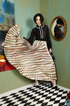Major maxi love! This pleated, striped maxi has a metallic element...Definitely made to move. We are loving it paired back to his black collared blouse with sequin detail. #aliceandolivia #aofal16