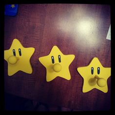 Star pegs found @ Hobby Lobby, painted yellow and added the eyes... perfect for Landon's Mario room!!
