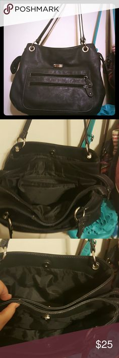 Laura Scott purse Has 3 big separate compartments and multiple pockets. The inside has makeup glitter but I can clean before I send out. Very nice and roomy purse. Laura Scott Bags