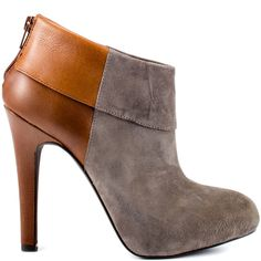 Keep up with changing trends in the Audriana.  Jessica Simpson brings you a contrasting upper of grey suede and brown leather.  A sewn cuff detail, 4 inch heel and 1/2 inch platform tie up this on trend ankle boot.