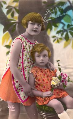 Two young girls in orange dresses Vintage Tinted Postcards