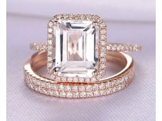 Aquamarine-March BirthstoneGemstone can be replaced with other birthstone.Material: Solid 14k Gold( White/Rose/Yellow gold available,14 &18k available)Engagement Ring:Bottom Band Width: approx 1.2-1.4mmMain stone: 8x10mm Emerald Cut 4.0ctw Natural White Topaz,VS ClarityAccent Stones: 0.28ct Round Cut Natural Conflict Free Diamonds,SI Clarity,H colorCut: Very-GoodSetting: Prong,PaveMatching Wedding Bandx2:Width 1.2mm0.15ct Round Cut Natural Conflict Free Diamonds,SI Clarity,H...