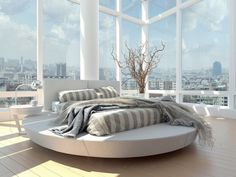 Круглая кровать в спальне: необычно и очень практично (фото) http://happymodern.ru/kruglaya-krovat-38-foto-neobychno-ili-praktichno/ Удобная и функциональная круглая кровать с прямоугольным матрацем, столиком и настольной лампой