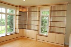 contemporary built in bookcase around window