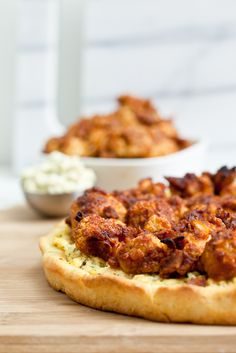 Please your party guests with this Buffalo Cauliflower Wing Pizza with Tofu Blue Cheese Spread!