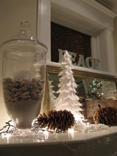 Pretty white feather tree with accenting pine cones