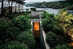 Designed as a painter's retreat, Studio Bahia Azul by Felipe Assadi Arquitectos leaves you alone with your canvas - and the sea. The building, located in Los Vilos, Chile, extends the frame-like entranceway and stairs with a single concerte wall...