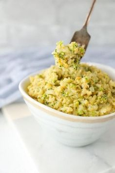 Creamy, delicious, and EASY, this Keto Cheesy Broccoli & Cauliflower Rice is the perfect healthy low carb side dish! Vegetarian, egg free, nut free, Atkins