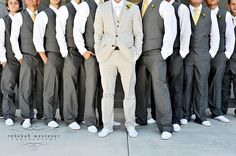 Charcoal colour pants for the groomsmen, suspenders for the guys, duckegg colour ties with white sneakers.