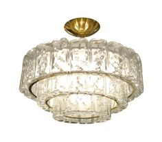 Brass chandelier composed of three tiers of glass elements with relief detail by Kalmar.