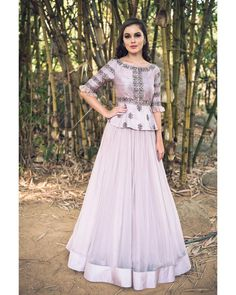 Beautiful lehenga in light grey shade with embroiodery on the top. Meenakshi collection from Mrunalini rao.br>Elegance persnified in this beautiful lehenga. 12 January 2018