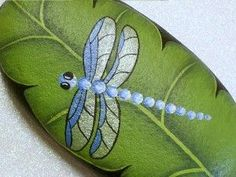 Silver blue dragonfly on green leaf, hand painted rocks by Rockartiste