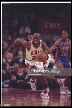 Guard Michael Jordan of the Chicago Bulls dribbles the ball hard up the court on a fast break during a game against the Detroit Pistons at the United...