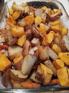 Delicious roasted potatoes, squash and carrots.  For this recipe i had some squash and potatoes i needed to use up and it turned out so tasty. Since I'm terrible at remembering to coat my dishes and pans when cooking in the oven the first thing i did was spray my 9x13 glass pan with some nonstick spray. You can alter it how you like but i used one whole butternut squash with rind cut off and chopped into large bite sized pieces, about four each of red and russet potatoes scrubbed with skin o...