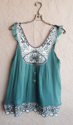 Green babydoll tunic with crochet straps on Etsy, $20.00