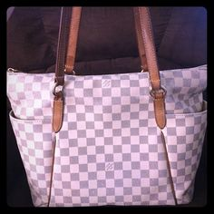 Authentic Louis Vuitton Totally MM Authentic LV totally MM Damier Azur with serial number seen on pics.Canvas is great with small tear on the zipper area!Corners show light rubbing, leathers shows natural wear and light fading of buckles and zipper !Small pen marks on one side of the outer pocket! No dust bag and receipt! Bought this purse 5 years ago and left everything in my hometown when moved here! Interested buyers can ask for more pics and if you have some questions just let me know…